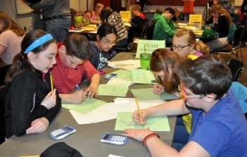 Students in the sixth-grade Harlequin Team from Paris Elementary School work on a math problem. Clockwise, from front left, are Abby Steeves, William Dieterich, Annie Choi, Katerina Crowell, Halie Page and Sebastian Brochu.